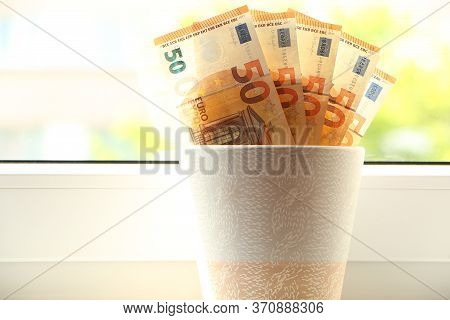 Paper Money Grows In A Flower Pot On A Windowsill. Economic Growth. Salary Growth. The Growth Of Int