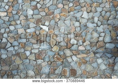 Texture Of Masonry From Rubble Of Gray And Brown Diorite Volcanic Rock