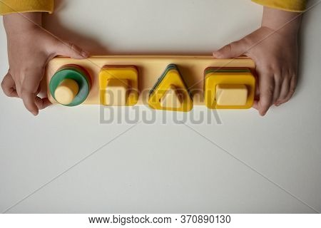 The Boy Is Playing In His Room. Educational Game. Learning Shapes And Colors. A Child Plays With A S
