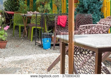 Kathmandu, Nepal - June 8, 2020: Chairs And Tables Are Being Set Up To Welcome Diners.  A Restaurant