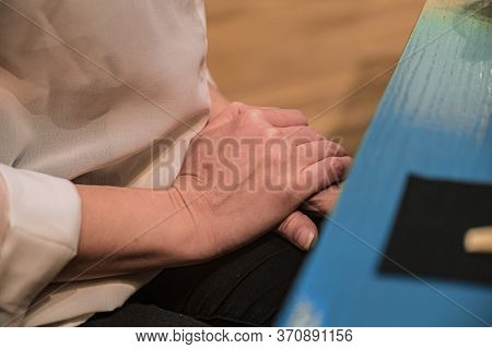 Closeup Of Girl's Hands On Top Of Each Other During Negotiations. A Woman Hands On Top Of Each Other