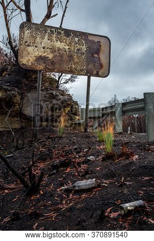 Burnt Road Sign, Rubbish And Landscape After Bush Fires In Blue Mountains, Australia.