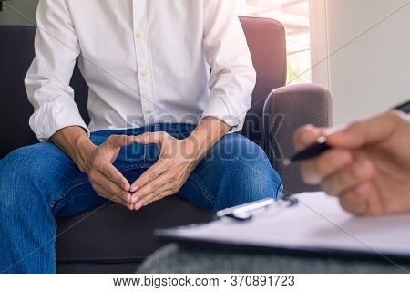 Men  With Mental Illness Sitting And Talking With A Psychiatrist To Heal The Mind And Find A Cure.