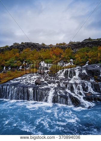 Incredibly Beautiful Hraunfossar Waterfall. Lava Waterfalls. Waterfall Flowing Down From The Lava Fi