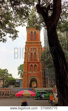 Ho Chi Minh City, Vietnam - March 28, 2019: Side View Of The Tower Of The Notre-dame Cathedral Basil