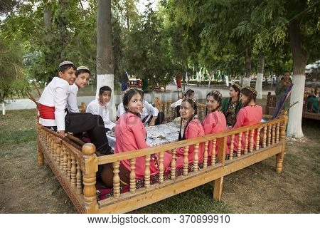 Ashgabat, Turkmenistan - August, 14, 2019: Group Of Young Musicians In Traditional National  Clothes