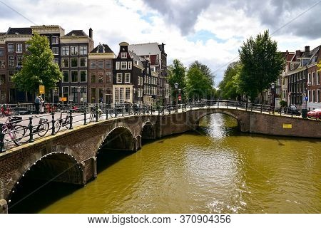 Amsterdam, Netherlands - September 3, 2019: Amsterdam Canals, Bridges And Streets.