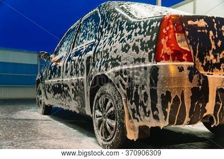Close Up Clean Car Concept At Car Wash. Washing Car With Soap. Car Wash
