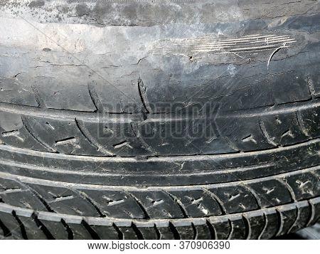 Old Automobile Tread. Summer Shabby Tire Tread, Close Up Image.