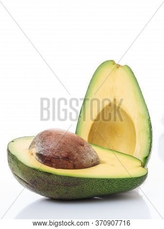 Healthy Lifestyle Concept. Avocado Cut In Two Isolated On White Background. Fresh, Green Fruit Veget
