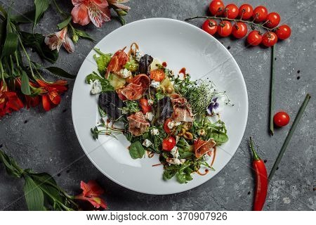 Salad With Ham And Pear On Dark Gray Background. Jamon Salad, Salad Mix, Spinach, Pear, Cherry Tomat