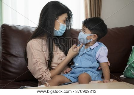 Coronavirus Covid-19 Concept.little Asian Boy With Mother Wearing N95 Mask For Protect From Coronavi