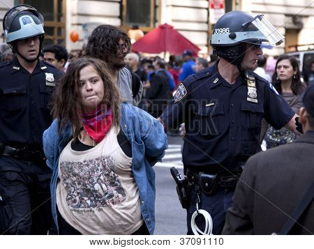 NEW YORK - SEPT 17: An unidentified woman being arrested on the 1yr anniversary of the Occupy Wall St protests on September 17, 2012 in New York City, NY.