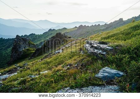 Awesome Mountain Landscape With Sharp Stones And Pointed Rocks Among Rich Vegetation On Hillside. Be