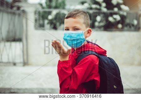 Child Wear Facemask During Coronavirus And Flu Outbreak. The Boy Wear A Mask Before Going To School