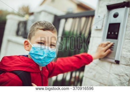 Child Wear Facemask During Coronavirus And Flu Outbreak. The Boy Wear A Mask When Back To Home Preve