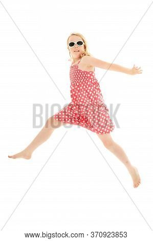 Beautiful Young Blonde Girl Jumping Across The Frame Wearing Pink And White Polka Dot Dress And Clas