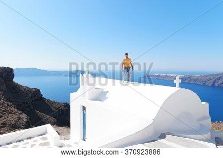 Santorini Greece, Young Men On A Luxury Vacation At The Greek Island Of Santorini
