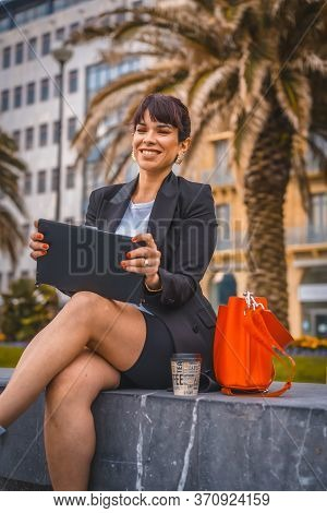 Entrepreneurial Session, A Young Businesswoman On Break From Work In A Black Blazer And White Sneake