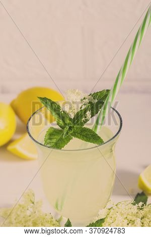 Elder Lemonade - Healthy And Refreshing Summer Drink. Close Up Of Homemade Elderflower Syrup In A Bo