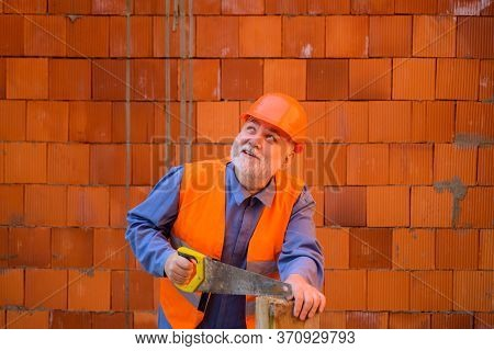Construction Worker Sawing With Hand Saw. Handyman With Hand-saw. Carpentry Work. Builder Worker Car