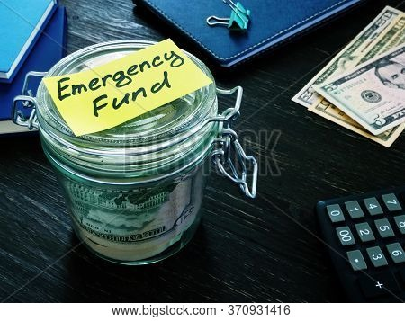 Money For Emergency Fund In The Glass Jar.