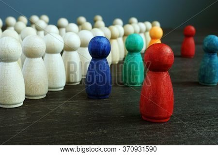 Inclusive And Discrimination Concept. Lines Of Wooden Figurines And Different Ones As Symbol Of Dive