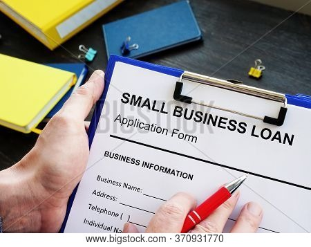 Empty Form For Small Business Loan And Pen.