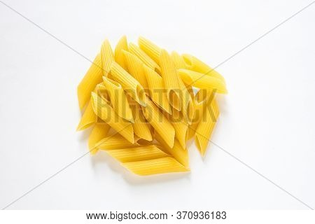 Traditional Italian Penne Pasta Isolated On White Background, Heap Of Penne Pasta, Durum Wheat Noodl
