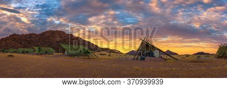 Sunrise Above Small Chalets Of A Desert Lodge Near The Namib-naukluft National Park Close To Sossusv