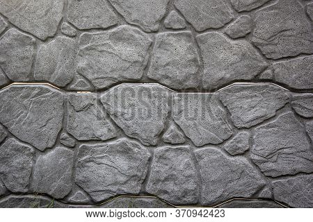 An Image Of A Grungy Weathered Limestone Rubble Wall Surface.