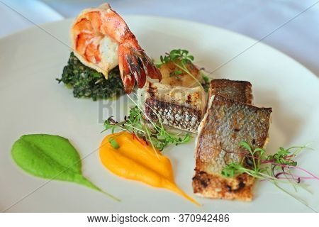 Grilled Prawn And Sea Bass Fish In A Fine Dining Plate