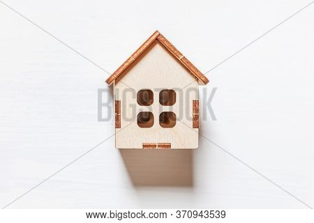 Simply Minimal Design With Miniature Toy House Isolated On White Background. Mortgage Property Insur