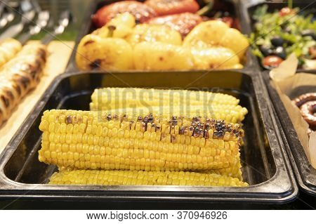 Fresh Roasted Or Grilled Tasty Corncobs For Sale On The Street Market
