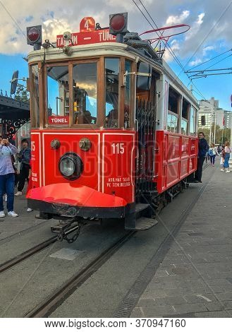 Istanbul, Turkey - October 6, 2019: Famous Red Retro Tram In Taksim Square. Popular Tourist Tramway