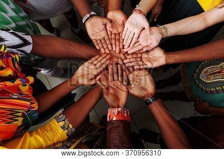 Palms Up Hands Of Happy Group Of Multinational African, Latin American And European People Which Sta