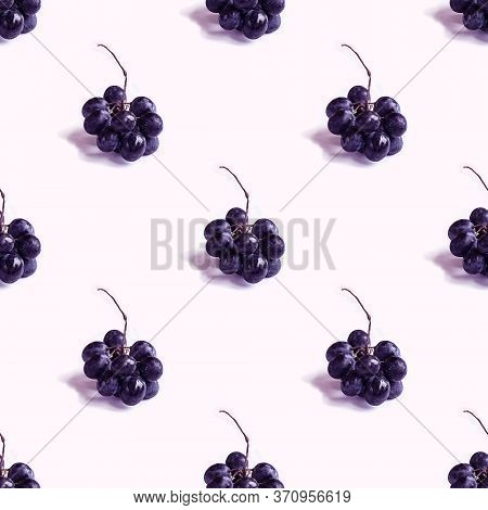 Trendy Seamless Pattern With Small Bunch Of Black Round Grapes With Shadow On Blank White. Photograp
