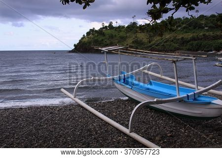 Jukung Boat On Cloudy Day In Bali, Indonesia. Amed Has Become A Popular Tourist Destination And Is L