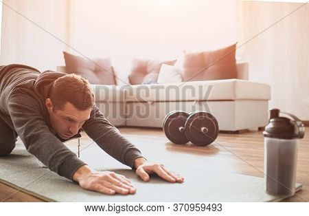 Young Ordinary Man Go In For Sport At Home. Cut View Of Beginner Guy Stretching His Body And Pull Ha