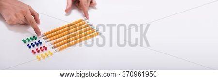 Compulsive Perfectionist Hand Arranging Pencils. Ocd Person