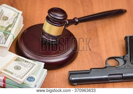 Trial For Robbery With Murder. Murder And Robbery Of Businessman And The Court. Money, Gun And Judge
