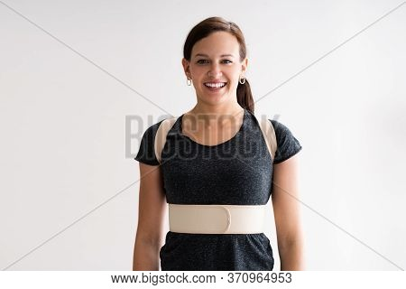 Happy Woman Wearing Posture Corrector Belt Or Physio Decompression Back Belt