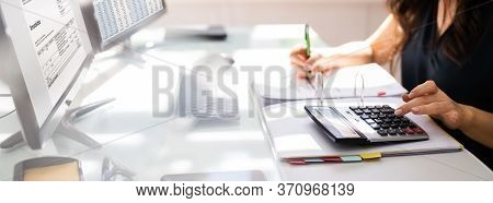 Chartered Accountant Hand Calculating Tax And Salary