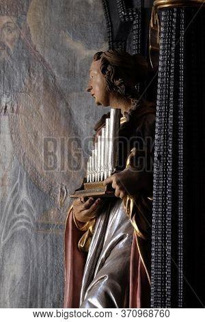 ZAGREB, CROATIA - SEPTEMER 26, 2018: Saint Cecilia, statue on the altar of Saint Apollonia in the Church of Saint Catherine of Alexandria in Zagreb, Croatia