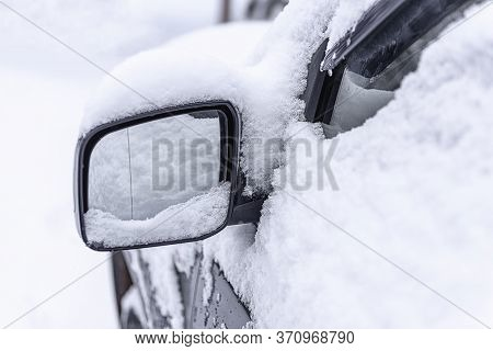 Car Mirror In The Snow Close-up. Side Mirror Of Car. Car Standing In Snow. Snowdrift Snow By Car. Sn