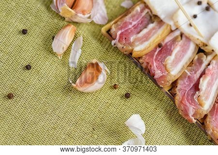 Bacon Sliced And Sliced Garlic. Fresh Bacon In Plate. Bacon With Garlic.