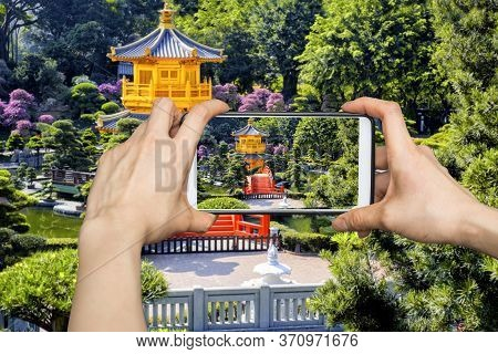Girl Taking Pictures On Mobile Smart Phone In Front View The Golden Pavilion Temple In Nan Lian Gard