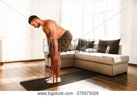 T-shirtless Guy Sportsman In Go In For Sport At Home. Young Man Doing Sport Workout In Room During Q