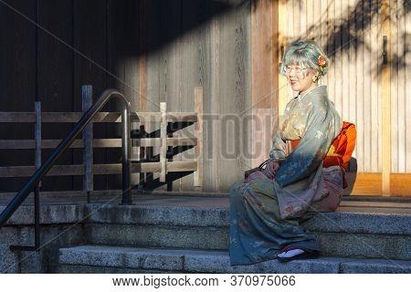 Kyoto, Japan - November, 8, 2019: Beautiful Japanese Geisha In Silk Kimono In Traditional Environmen