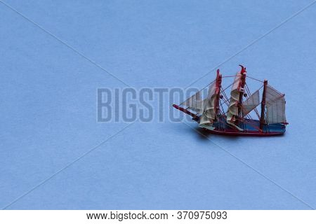 Travel Concepts. Scale Model Of Three-masted Sail Boat Placed Over Blue Background.horizontal Image